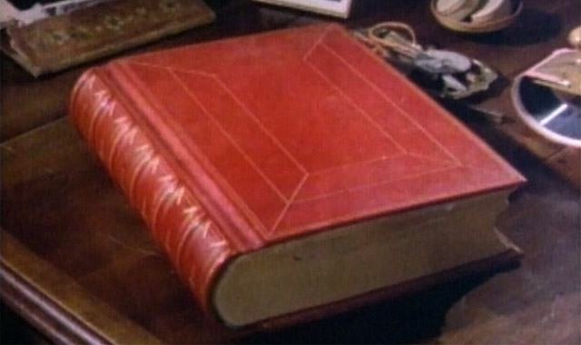 The Red Book (Liber Novus) by C. G. Jung, resting on Jung office desk.
